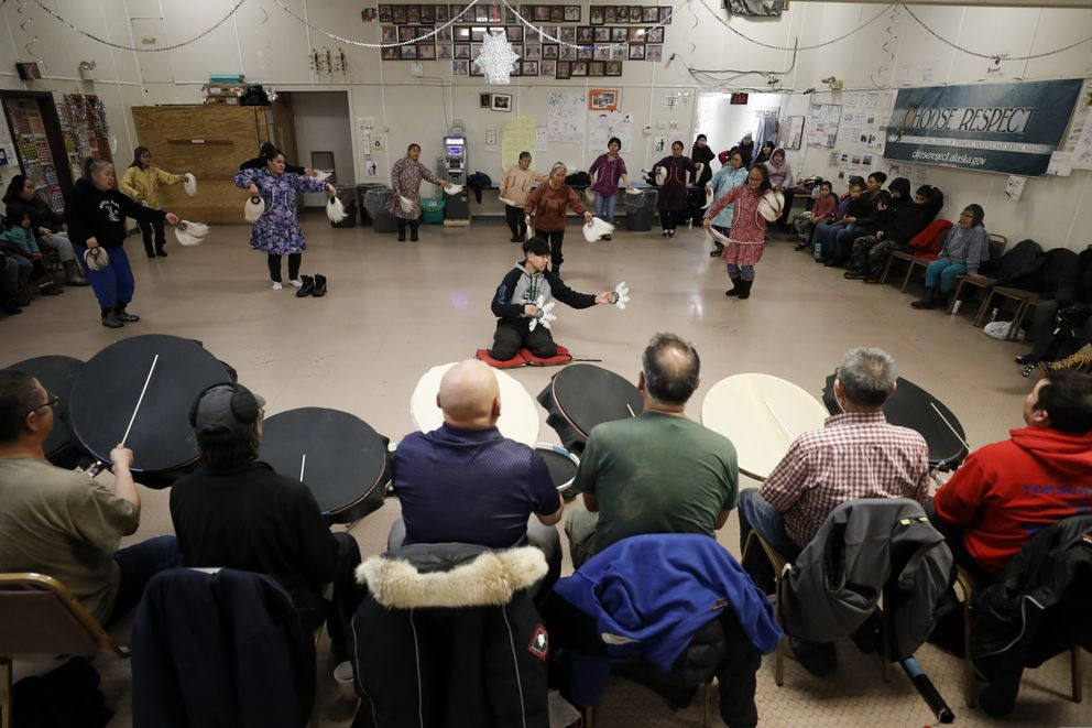 In this Monday, Jan. 20, 2020 photo, people take part in an Alaska Native dance in Toksook Bay. (AP Photo/Gregory Bull)