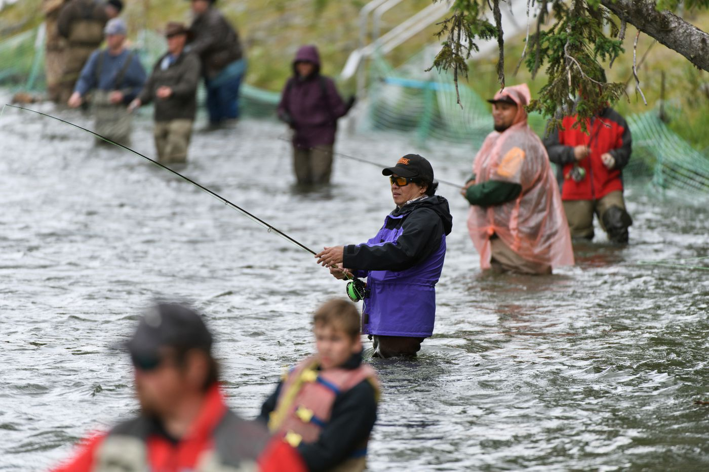 Michael Snow fishes on the Kenai River on June 22. Snow, from the Philippines, moved to the U.S. for educational opportunities for his three kids. (Marc Lester / ADN)