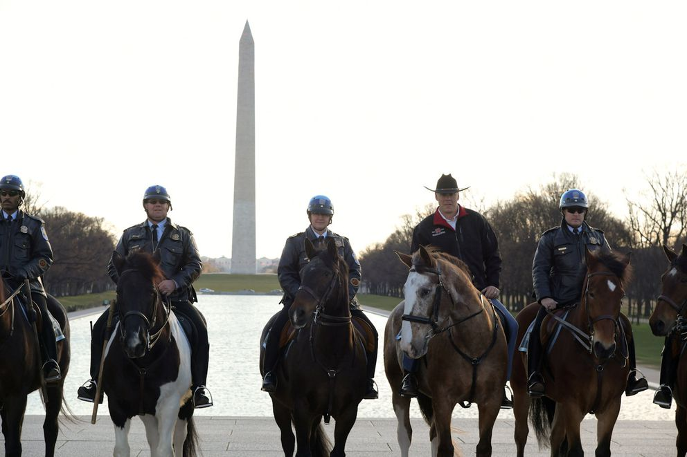 New Interior Secretary Ryan Zinke (second from right) rides on horseback with a U.S. Park Police horse mounted unit while reporting for his first day of work at the Interior Department in Washington, U.S., March 2, 2017. (Tami Heilemann/Department of Interior)