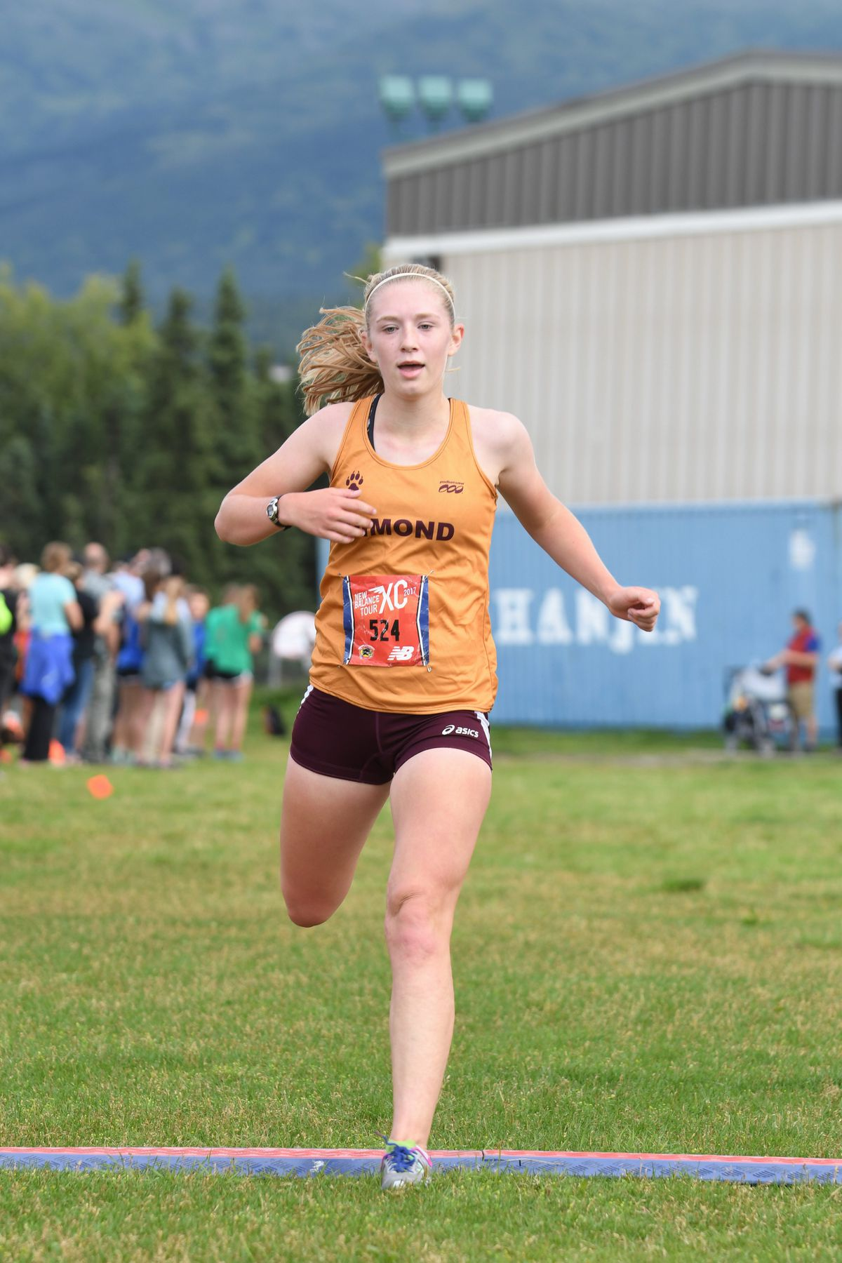 Dimond's Kylie Judd crosses the finish line to claim victory in a three-team meet at Service High on Friday8. (Photo by Urban Enkvist)