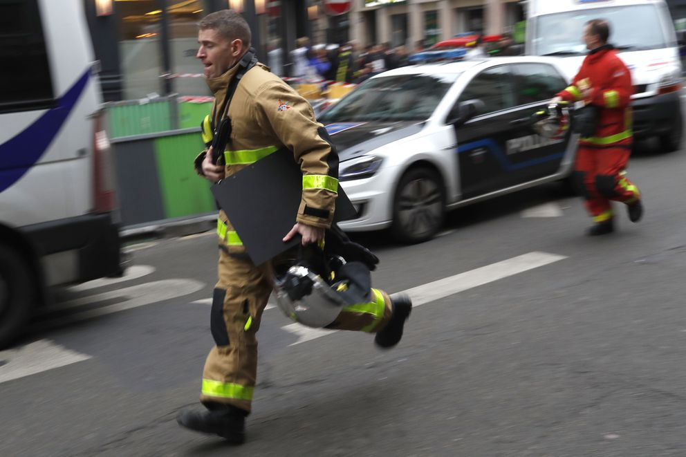 A firefighter rushes to the scene of a gas leak explosion in Paris, France, Saturday, Jan. 12, 2019. A powerful explosion and fire apparently caused by a gas leak at a Paris bakery Saturday injured several people, blasted out windows and overturned cars, police said. (AP Photo/Thibault Camus)