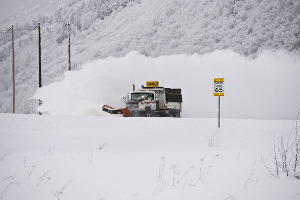 An Alaska Department of Transportation plow clears a stretch of the Seward Highway near Girdwood on January 29, 2020. (Marc Lester / Anchorage Daily News)