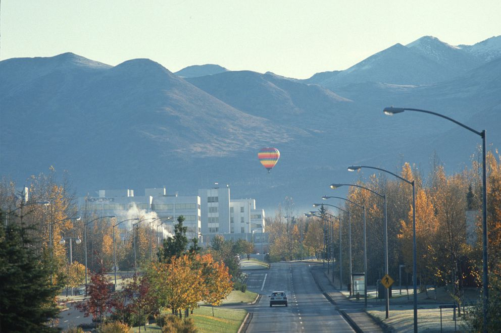 A hot air balloon drifts low on the east side of Anchorage behind Providence Hospital Sunday morning on October 6, 1991. (Jim Lavrakas / ADN archive)