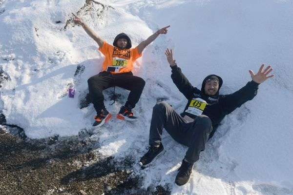 Kowin Souhala and Joe Matha cool off in the snow after finishing the race. (Photo by Bob Hallinen)