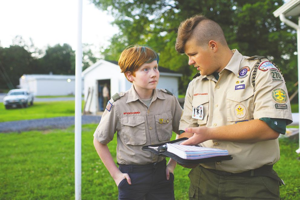 Aidan Johnson, left, 12, and Charlie Farkas, 14, a troop leader, at one of Troop 270's weekly meetings last month in Thurmont, Md. (Washington Post photo by Marvin Joseph)