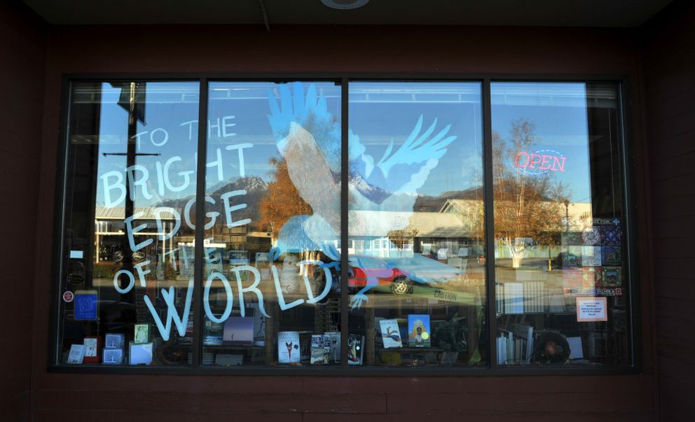 Tiffany Cheezem painted the cover of author Eowyn Ivey's second novel on the front window of Fireside Books in Palmer. Ivey worked at the independent bookstore for nearly a decade. (Bob Hallinen / Alaska Dispatch News)