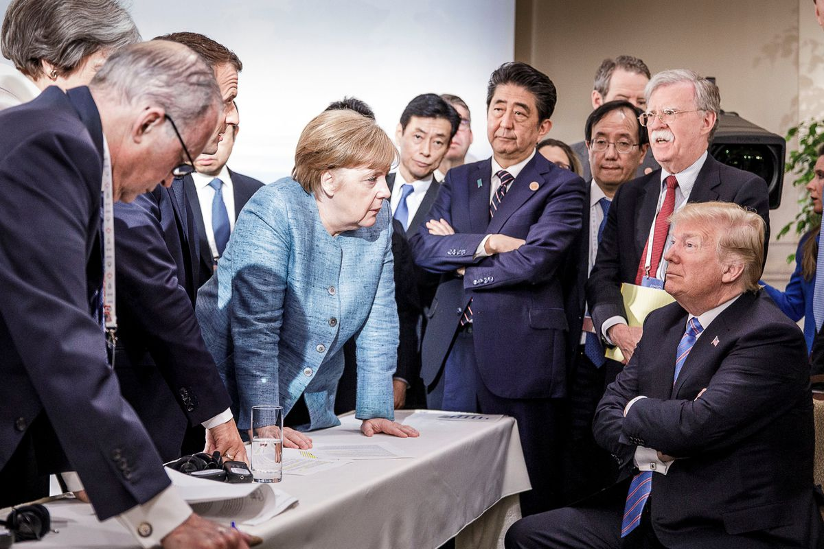 German Chancellor Angela Merkel speaks to U.S. President Donald Trump during the second day of the G7 meeting in Charlevoix city of La Malbaie, Quebec, Canada, June 9, 2018. Bundesregierung/Jesco Denzel/Handout via REUTERS