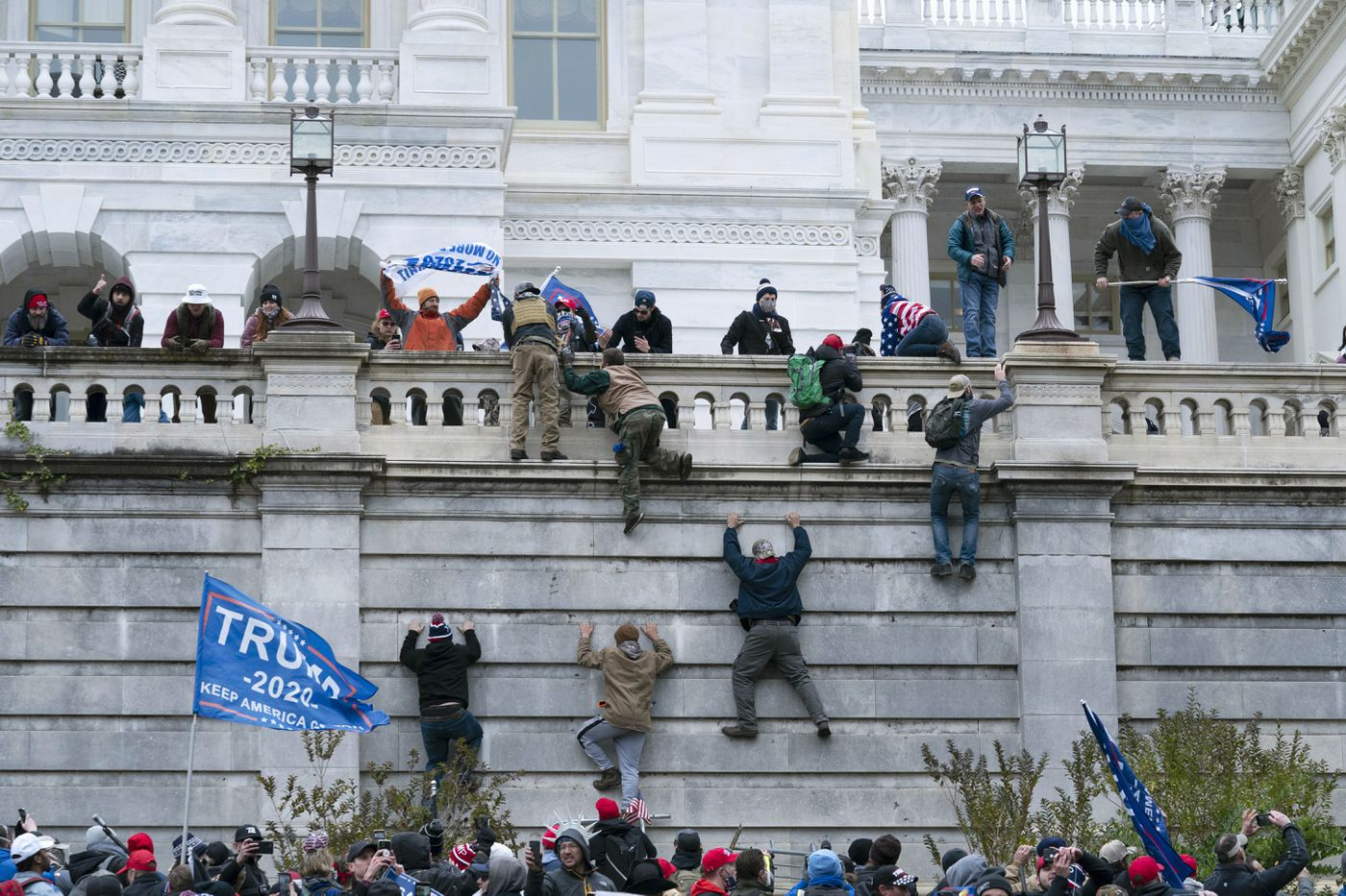 Supporters of President Donald Trump climb the west wall of the the U.S. Capitol in Washington. (AP Photo/Jose Luis Magana File)