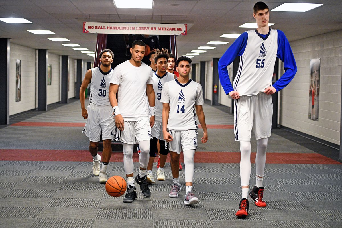 Robert Bobroczky, a 7-foot-7 teen from Romania, along with his teammates at SPIRE Institute, head to the court before their game against Woodstock Academy from Connecticut on Jan. 19 in Geneva, Ohio. Washington Post photo by Katherine Frey