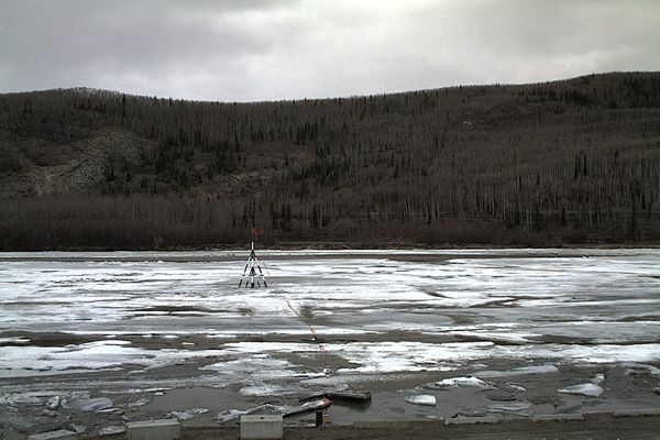 The Nenana Ice Classic tripod, pictured here in a Borealis Broadband webcam image, was still standing Friday evening, April 30, 2021, hours after the clock stopped. The 2021 Nenana Ice Classic ended at 12:50 p.m. Friday when the ice shifted and the clock inside a tripod set up on the river ice tripped. (Borealis Broadband webcam image)