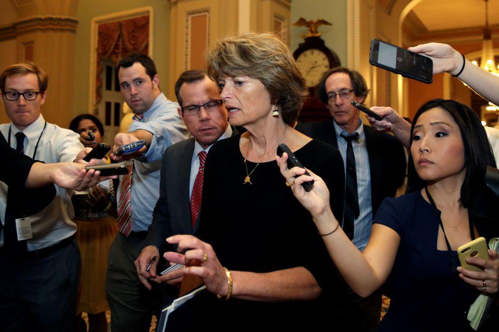 Senator Lisa Murkowski (R-AK) talks to reporters as she arrives for a Senate health care vote on Capitol Hill in Washington, U.S., July 27, 2017. REUTERS/Yuri Gripas