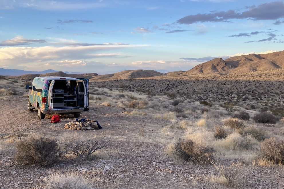 A campervan rental is parked at a campsite on public land managed by BLM just outside of Valley of Fire State Park in southern Nevada, on May 23, 2021. (Photo by Alli Harvey)