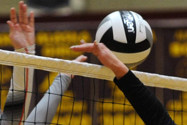 Wrangell senior Anna Allen and King Cove sophomore Jalayla Duarte battle at the net during the 2A state volleyball championships at Dimond High on Thursday, Nov. 30, 2017. (Bill Roth / ADN)