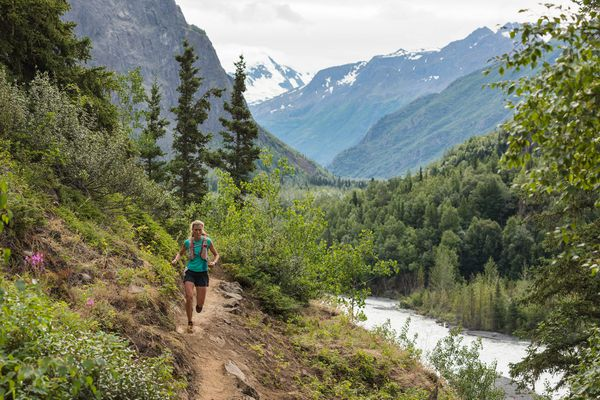 Christy Marvin runs toward the Perch during the Crow Pass Crossing race Saturday. Marvin won the women's division for the fourth time in 3:32:21.6. (Loren Holmes / ADN)
