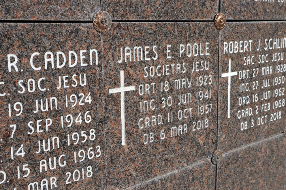 This Oct. 22, 2018 photo shows the marker for where the remains of Rev. James Poole are interned at Mount St. Michael in Spokane, Wash. Over the course of his life, Poole was accused of sexually abusing at least 20 women. (Emily Swing/Reveal via AP)