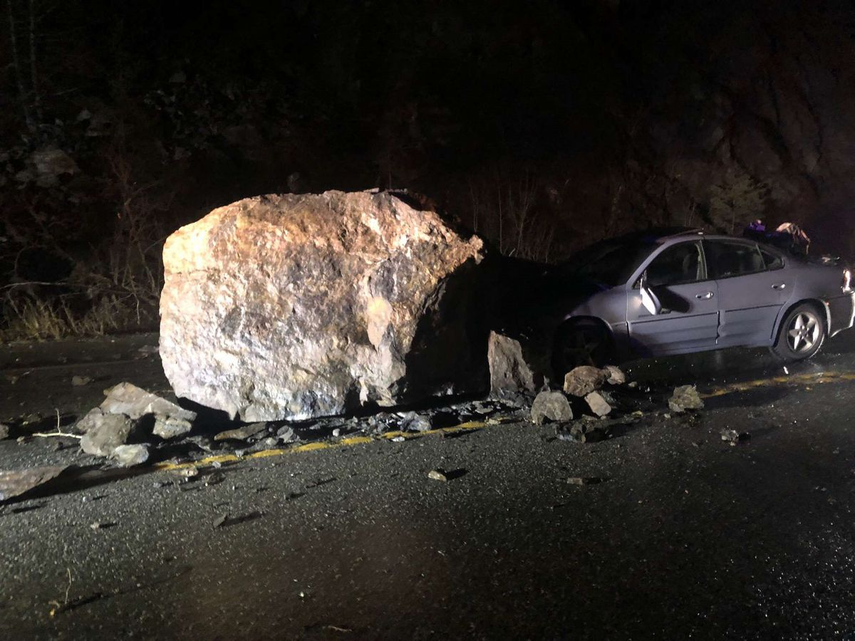 A car crashed into a 6-foot-by-8-foot rock near Beluga Point on Dec. 11, 2019. (Photo courtesy of Alaska Department of Transportation)