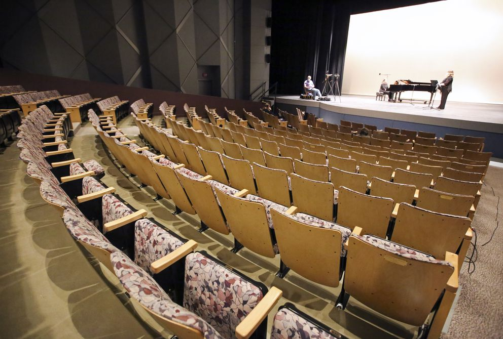 Soprano Kara Guggenmos, right, and pianist Janet Carr-Campbell rehearse before recording their songs in the Sydney Laurence Theatre at the Alaska Center for the Performing Arts in downtown Anchorage on Thursday, March 25, 2021. (Emily Mesner / ADN)