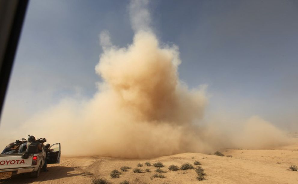 Smoke rises from a bomb taken through the window of a military vehicle in Qayyarah during an operation to attack Islamic State militants in Mosul. REUTERS/Alaa Al-Marjani