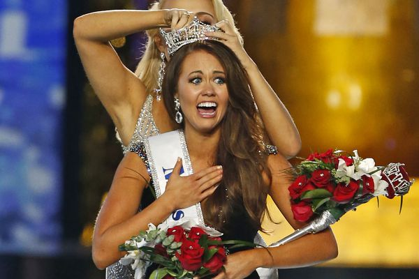 In this Sept. 10, 2017, file photo, Miss North Dakota Cara Mund reacts after being named Miss America during the Miss America 2018 pageant in Atlantic City, N.J. In a letter sent to former Miss Americas on Friday, Aug. 17, 2018, Mund says she has been bullied, manipulated and silenced by the pageant's current leadership, including chairwoman Gretchen Carlson. (AP Photo/Noah K. Murray, File)
