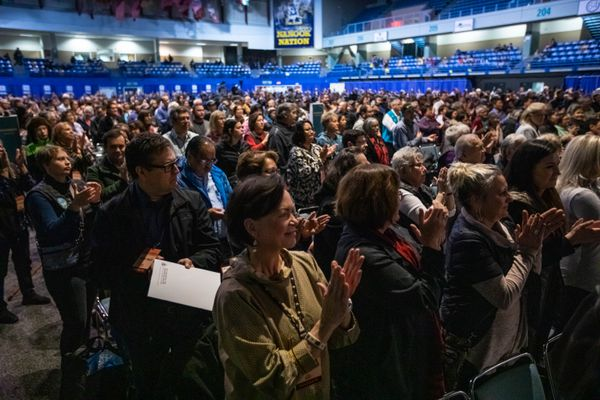 Alaska Federation of Natives delegates applaud during a presentation of the Shirley Demientieff award Thursday, Oct. 17, 2019 during the AFN convention at the Carlson Center in Fairbanks. (Loren Holmes / ADN)