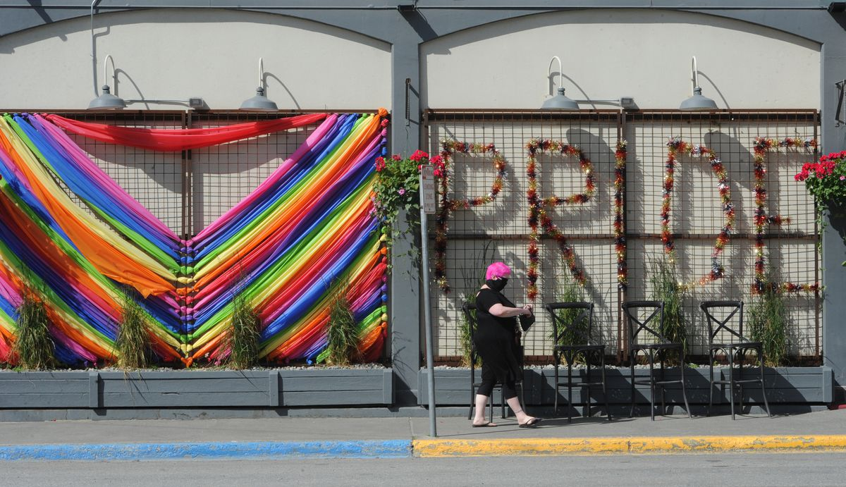 A customer walks past art work supporting Pride Month near the entrance of 49th State Brewing Co. in downtown Anchorage on Monday, June 15, 2020. The Supreme Court ruled on Monday that landmark civil rights laws protect LGBTQ+ employees from discrimination. (Bill Roth / ADN)