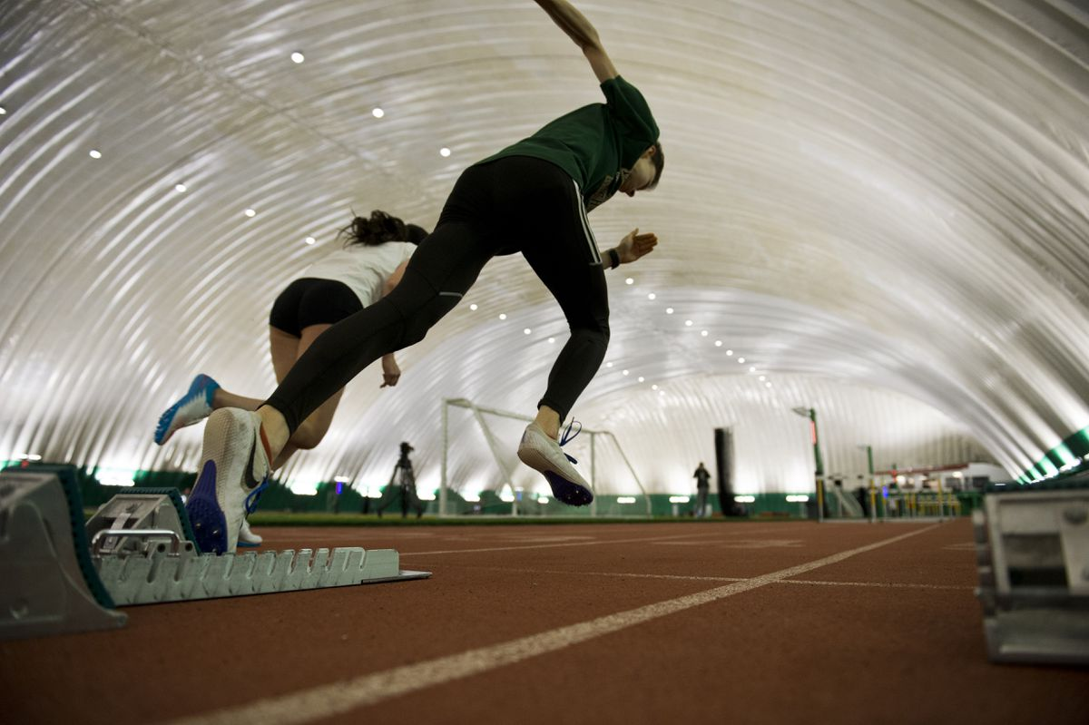 UAA track and field athletes Elena Cano, left, and Yvonne Jeschke, train inside The Dome. (Marc Lester / ADN)