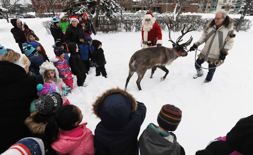 Two classes of kindergarten students from Inlet View Elementary School walked to Delaney Park to visit Star the Reindeer and learn about him from his owner Albert Whitehead on Thursday, Dec. 20, 2018. The children got a surprise visit from Santa Claus who said he was there to take a look at Star who is a reserve reindeer for his team when he makes the trip around the world delivering presents on Christmas Eve. Santa asked them how many days until Christmas Eve and 'who's been good this year? ' (Bill Roth / ADN)
