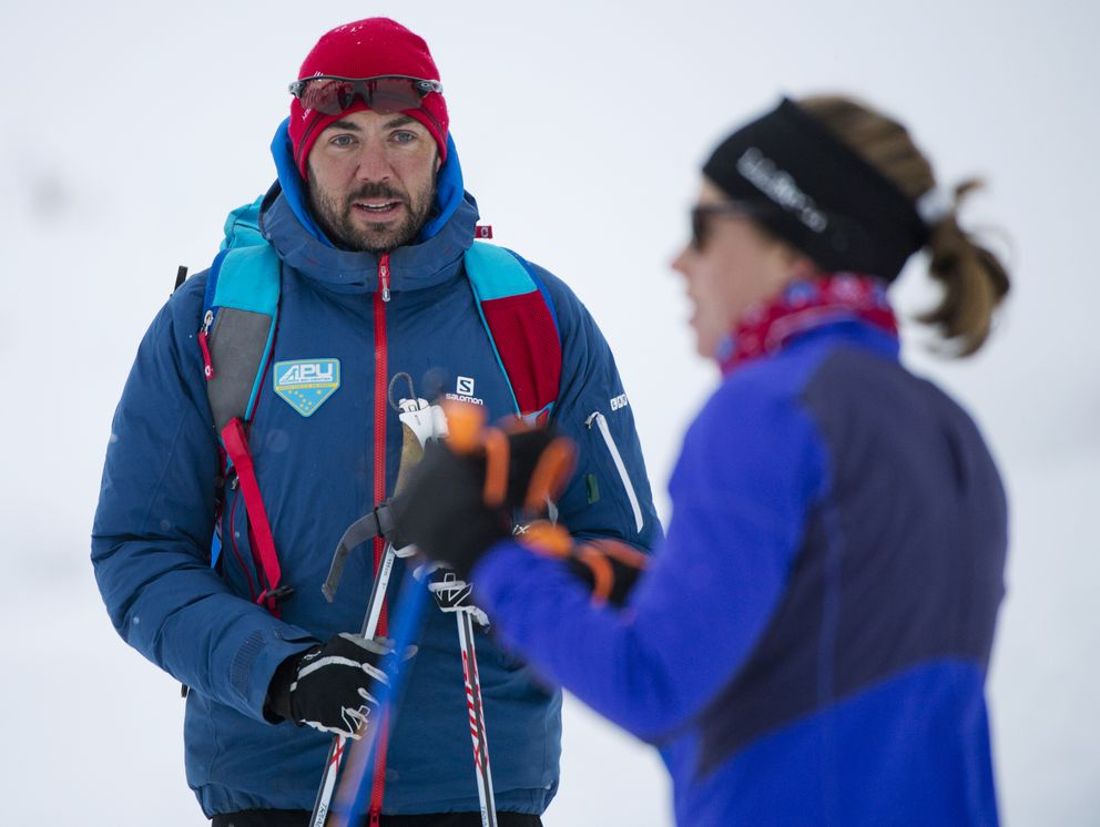 Erik Flora talks with one of his athletes at Hatcher Pass in October. (Marc Lester / ADN)