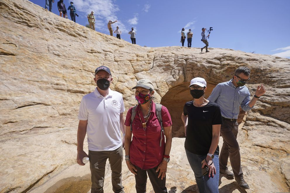 From left, Utah Gov. Spencer Cox, U.S. Interior Secretary Deb Haaland, Lt. Gov. Deidre Henderson and Rep. Blake Moore look on during a tour of ancient dwellings along the Butler Wash trail at the Bears Ears National Monument Thursday, April 8, 2021, near Blanding, Utah. (AP Photo/Rick Bowmer, Pool)