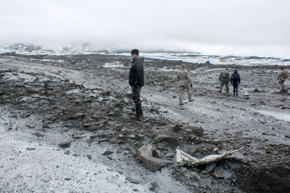 Allen Cronin stands amid debris on Colony Glacier on Wednesday. (Laurel Andrews / Alaska Dispatch News)
