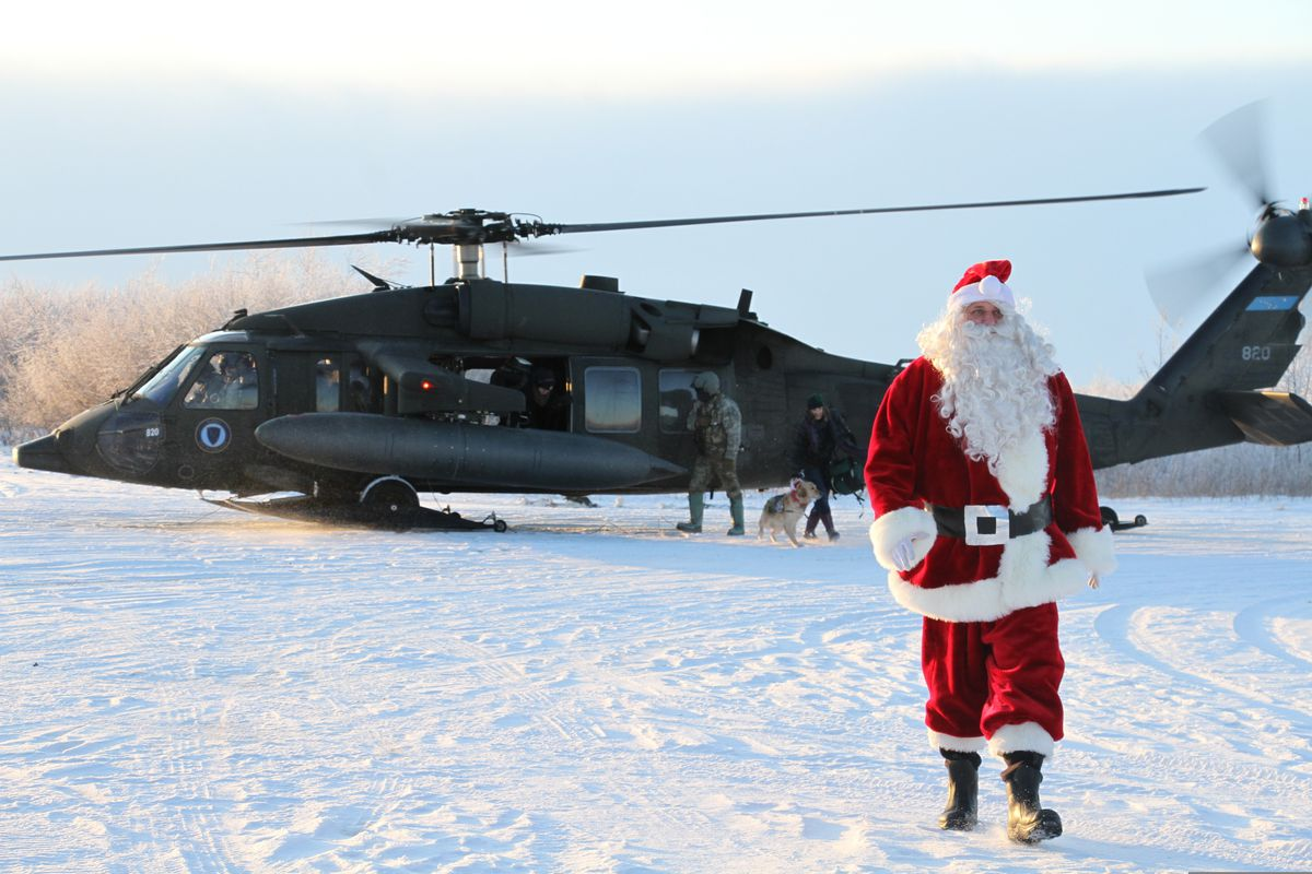 This Dec. 3, 2019 photo shows Santa Claus arriving in Napakiak on an Alaska National Guard UH-60 Black Hawk helicopter. The Guard brought its Operation Santa Claus to the Western Alaska community, which is being severely eroded by the nearby Kuskokwim River. (AP Photo/Mark Thiessen)