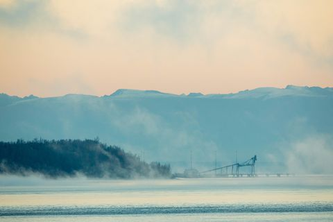 Clearing fog reveals Port Mackenzie, seen from Earthquake Park early Friday morning, Oct. 14, 2016. (Loren Holmes / Alaska Dispatch News)