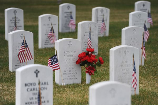 Bill Roth / Alaska Dispatch News American flags and flowers adorn headstones at Fort Richardson National Cemetery on Memorial Day, Monday, May 25, 2015.