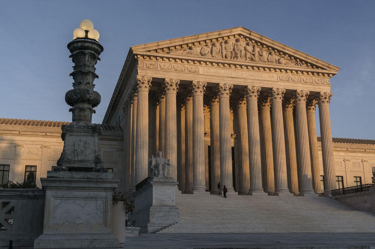 FILE - In this Nov. 6, 2020, file photo the Supreme Court is seen as sundown in Washington. (AP Photo/J. Scott Applewhite, File)