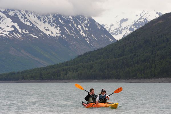 Matt Parrish and Rachelle Warner of Utah paddle a rental kayak during a visit to Eklutna Lake in the Chugach State Park on Wednesday, May 18, 2016. The glacial-fed lake is the water reservoir for the Alaska's largest city Anchorage. (Bill Roth / Alaska Dispatch News)
