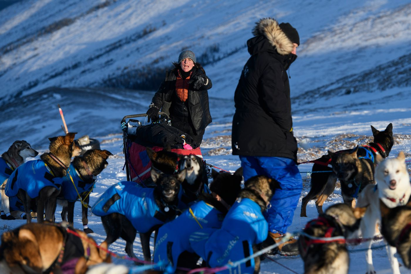 Michelle Phillips, of Tagish, Yukon, maneuvers around Hans Gatt at Eagle Summit. Yukon Quest International Sled Dog Race frontrunners passed checkpoints along the Steese Highway on February 10, 2019. (Marc Lester / ADN)