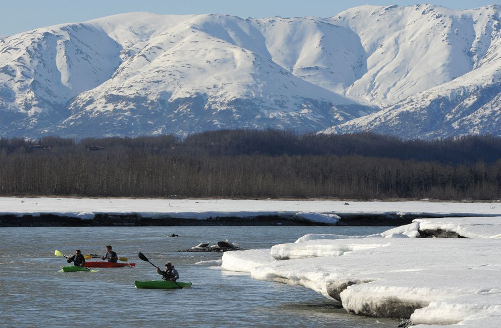 Kayakers paddle down the Matanuska River near Palmer on a sunny Monday, April 16, 2018. The Talkeetna Mountains are in the distance. (Bill Roth / ADN)