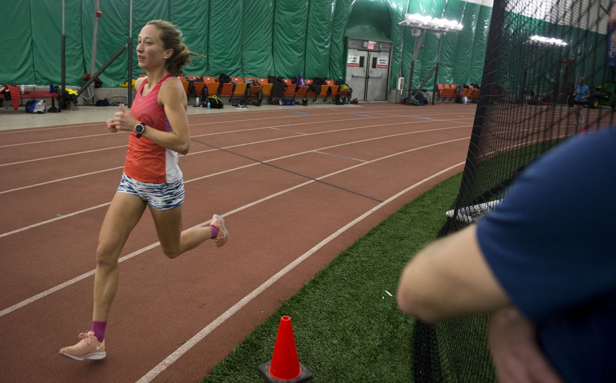 Anna Dalton trains at The Dome while Todd List of the Alaska Endurance Project calls out her split times. (Marc Lester / ADN)
