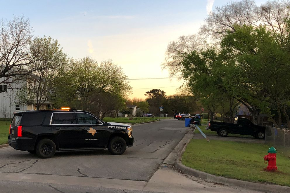 A Texas Department of Public Safety vehicle blocks a street into the neighborhood where the Austin bomb suspect may lived in Pfluggerville, Texas. REUTERS/Jon Herskovitz