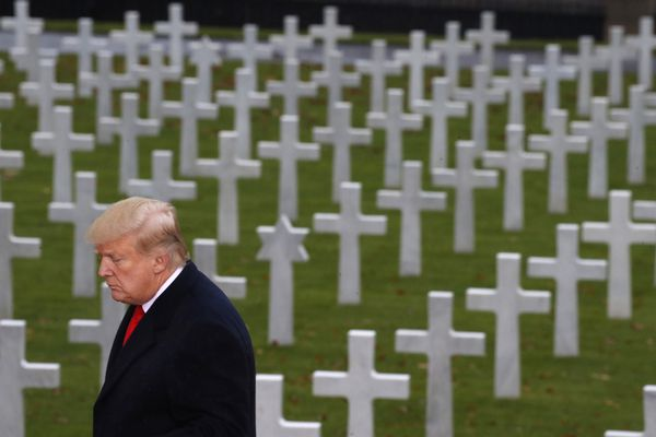President Donald Trump is backdropped by headstones as he prepares to speak during an American Commemoration Ceremony, Sunday Nov. 11, 2018, at Suresnes American Cemetery near Paris. Trump is attending centennial commemorations in Paris this weekend to mark the Armistice that ended World War I. (AP Photo/Jacquelyn Martin)