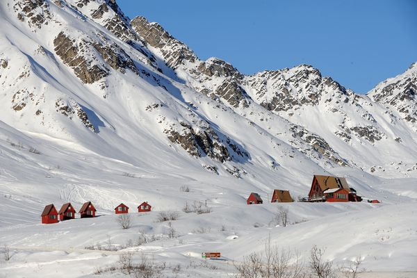 The Hatcher Pass Lodge and cabins soak up sunshine Tuesday afternoon, February 3, 2015, at the entrance to Independence Mine State Historical Park. (Erik Hill / ADN)