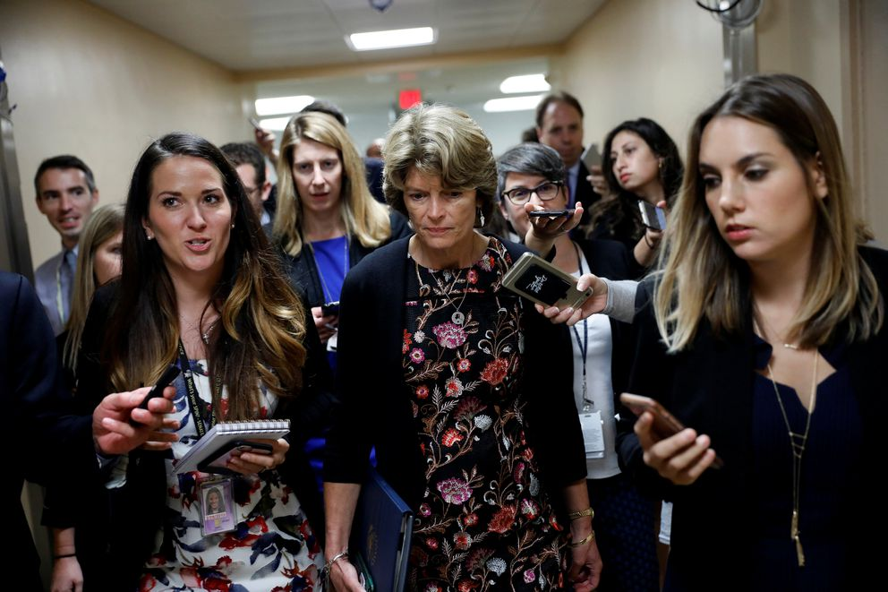 Sen. Lisa Murkowski, R-Alaska, speaks with reporters ahead of the party luncheons on Capitol Hill in Washington, U.S., Sept 19, 2017. REUTERS/Aaron P. Bernstein