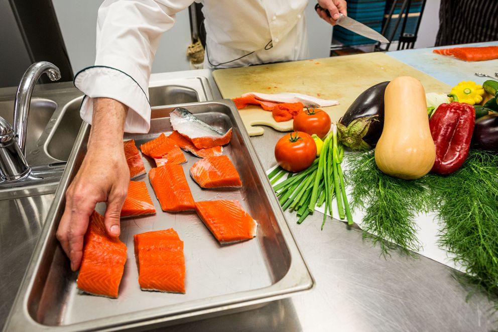 First of the season sockeye salmon being prepared at Crow's Nest. (Loren Holmes / ADN)