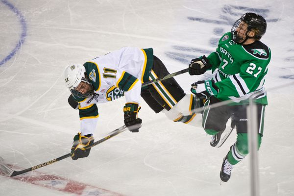 UAA's Austin Azurdia, left, collides with North Dakota's Ludvig Hoff in the first period. UAA played North Dakota in its home opener at the Sullivan Arena on October 6, 2017. (Marc Lester / Alaska Dispatch News)