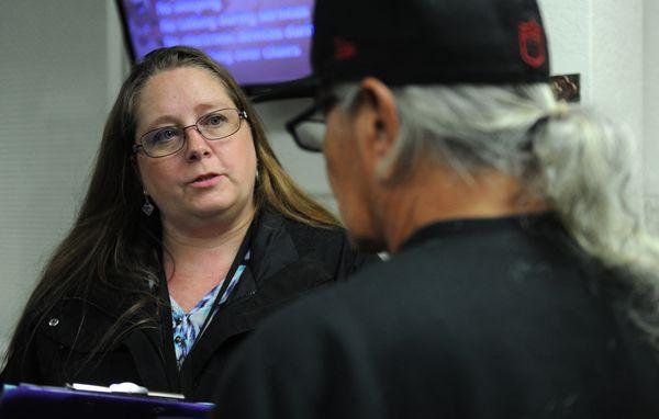 Social worker Tanya Vandenbos talks with Doug Shepardat the Gospel Rescue Mission. (Bob Hallinen / Alaska Dispatch News)