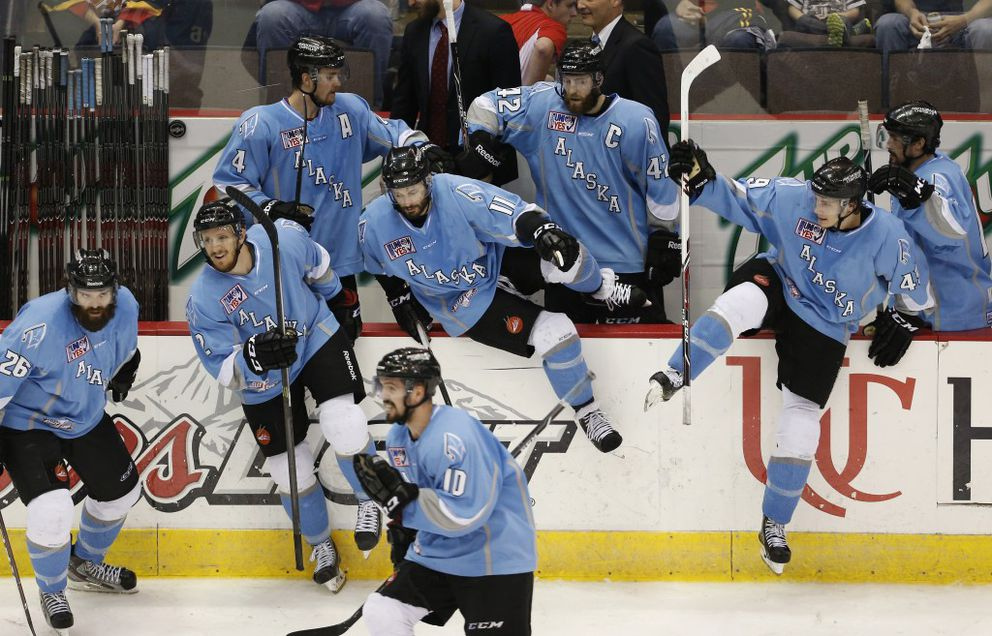 The Alaska Aces celebrate their 4-2 win over the Cincinnati Cyclones in Game 5 of their Kelly Cup championship series at US Bank Arena on June 7, 2014. (Jeff Swinger / The Enquirer)
