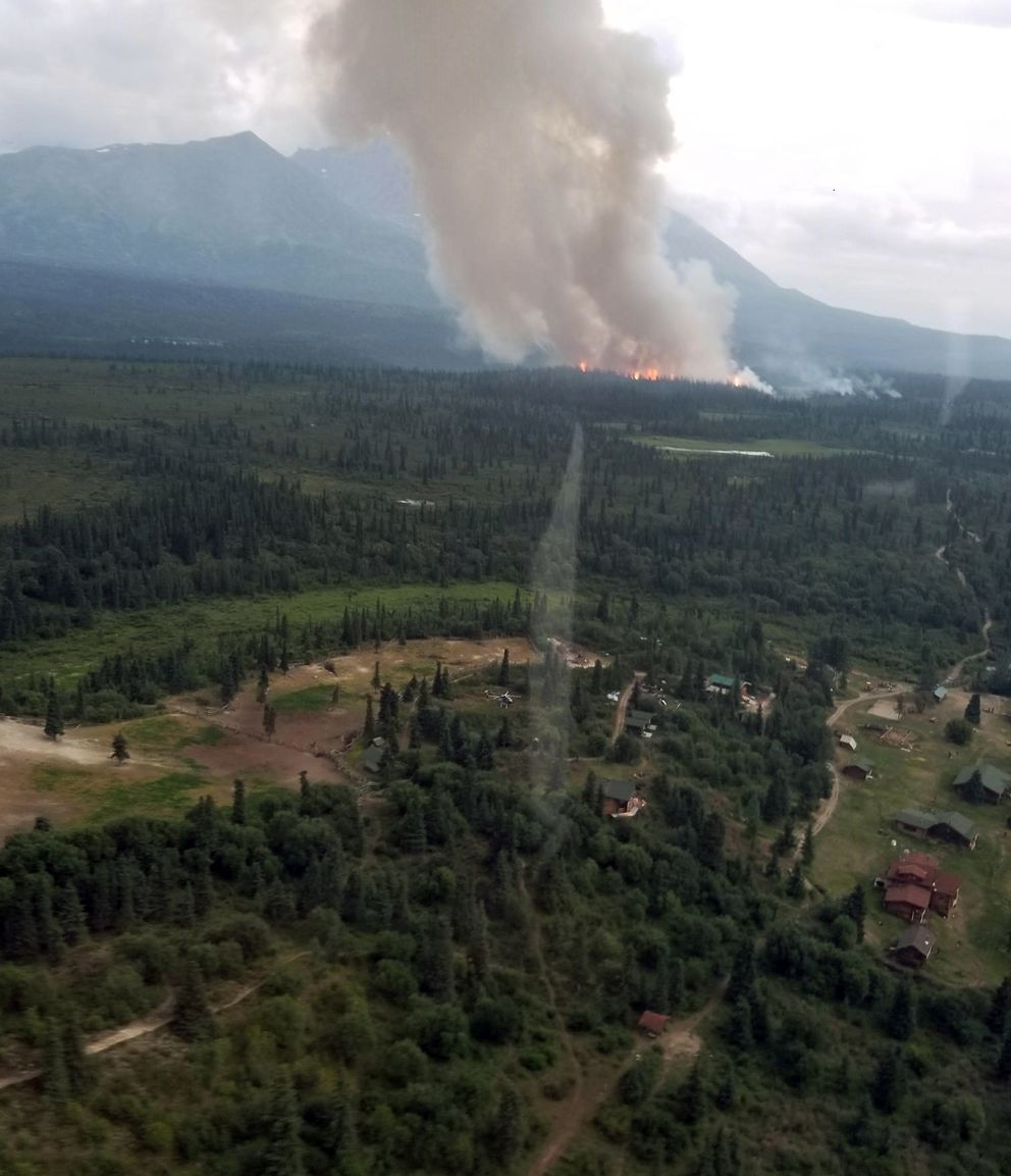 The smoke column from the Rainy Pass fire rises about a half-mile from Rainy Pass Lodge on Tuesday night, July 23, 2019. (Alaska Division of Forestry Air Attack)