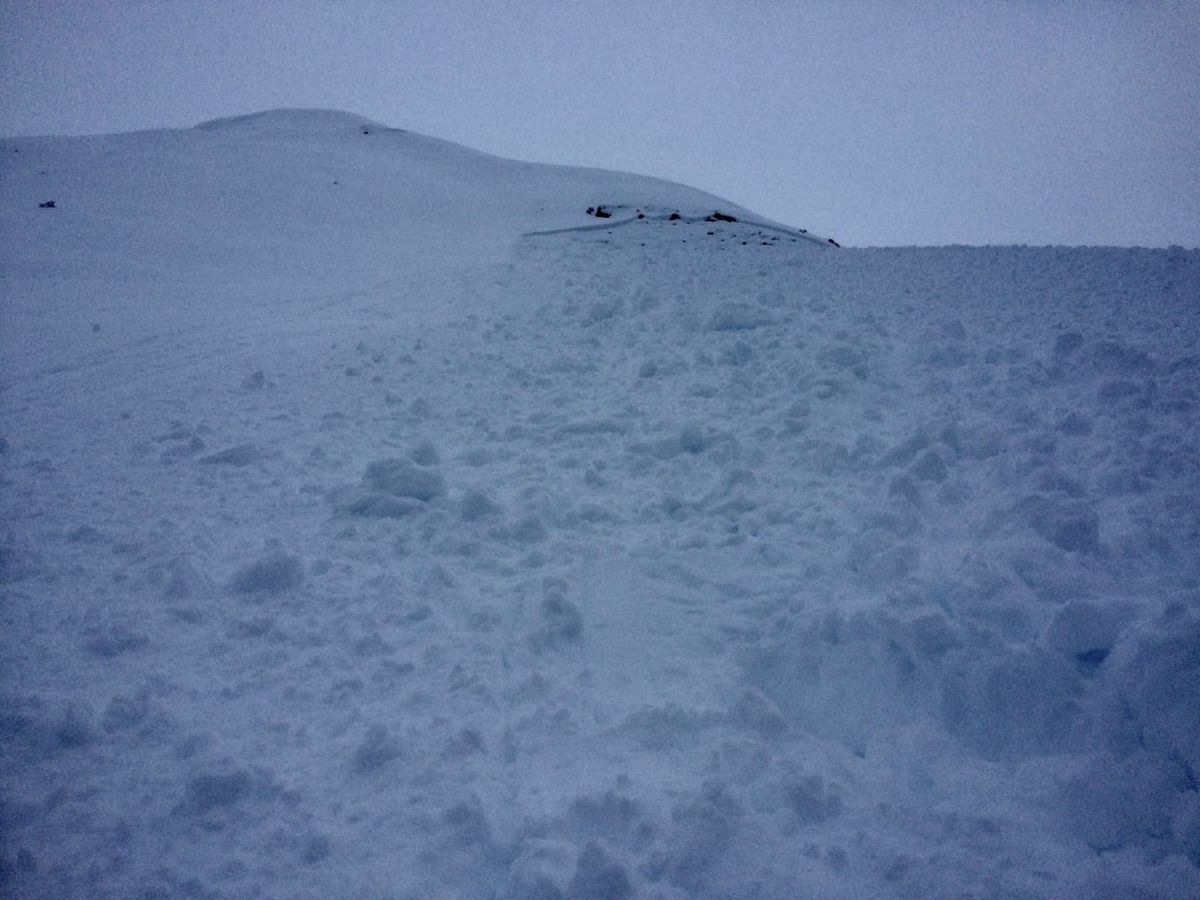 This avalanche, seen in a photo taken by one of three skiers carried 300 feet downhill by it, swept over the Lipps Ridge in Turnagain Pass on Thursday. The skiers were unhurt but avalanche danger still exists in the area headed into the weekend. (From CNFAIC)