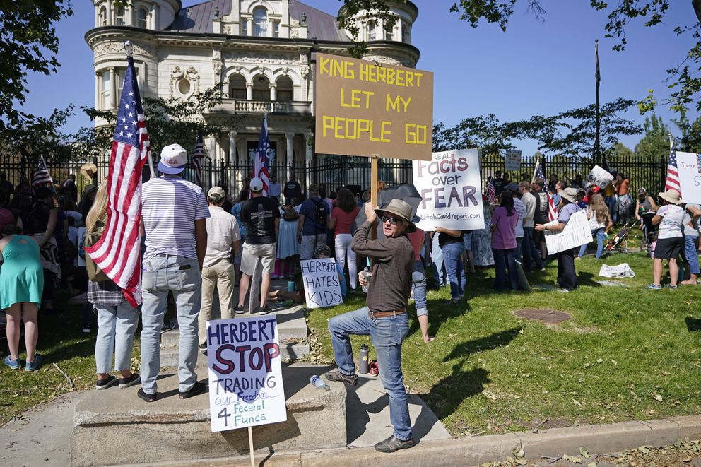In this Sept. 12, 2020, file photo, people protest Gov. Gary Herbert during an anti-mask rally outside of the Governors Mansion in Salt Lake City. (AP Photo/Rick Bowmer, File)