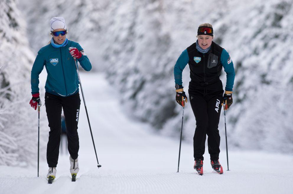 Hannah Halvorsen, right, skis with teammate Sadie Maubet Bjornsen on the Gasline Trail during a recent APU practice. (Marc Lester / ADN)